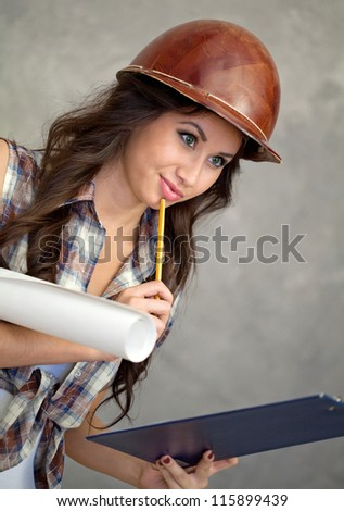 Young female engineer checking a plan