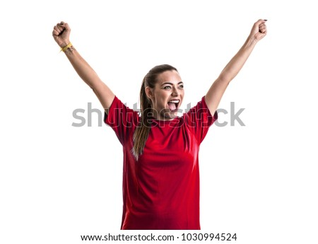 Young female fan on red uniform celebrating on white background #1030994524
