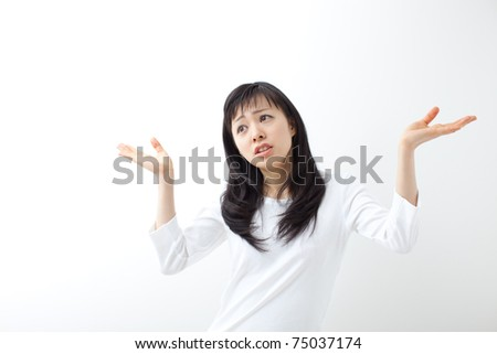 young female gesturing do not know sign against white background