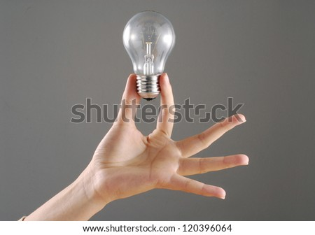 Young female hand holding a bulb.