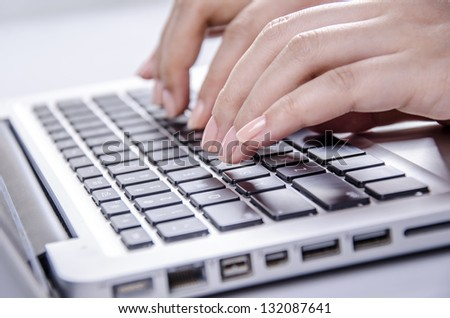 Young female hands on keyboard