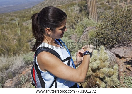 Young Female Hiker Checking Heart Rate