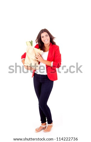 Young female holding a shopping bag on white background