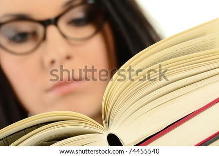 Young female holding an open book. Woman reading.