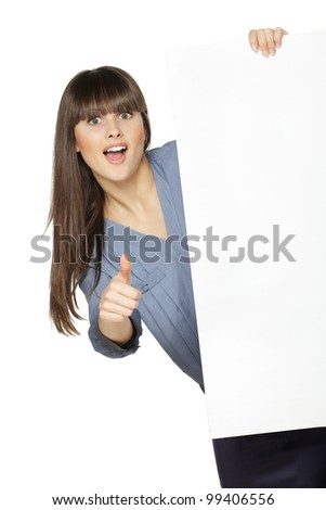 Young female holding the blank board and showing thumb up sign, isolated on white background