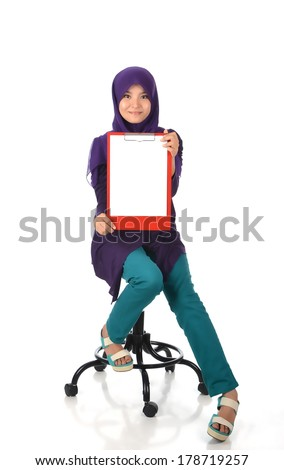 Young female holding writing pad