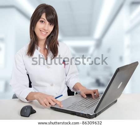 Young female hospital administrative in a desk at the hospital hall