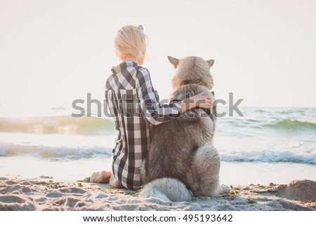 young female hugging with...