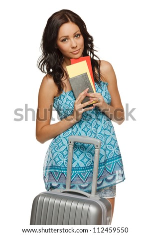Young female in casual standing with travel bag, holding passport and tickets,isolated on withe background