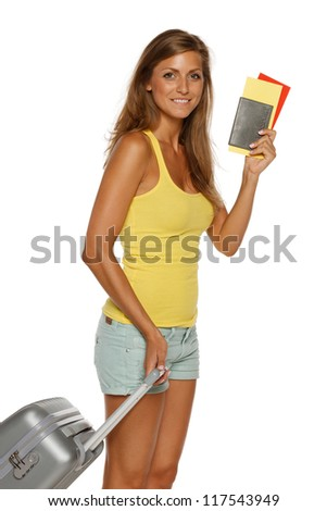Young female in casual standing with travel bag, holding passport and tickets,over white background