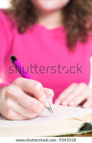 Young female is planning her work. Shallow depth of field. - stock photo