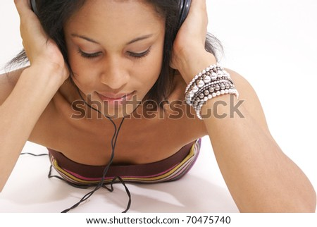 young female listens to her favorite song on her earphones.