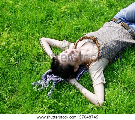 Young female lying on the grass in the park