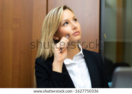 Young female manager in a pensive expression