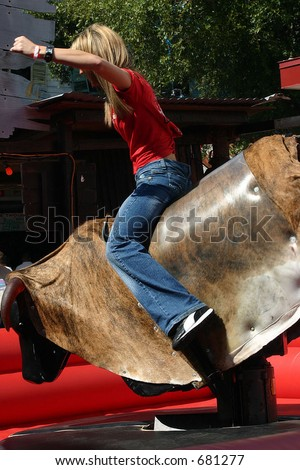 young female mechanical bull rider 2