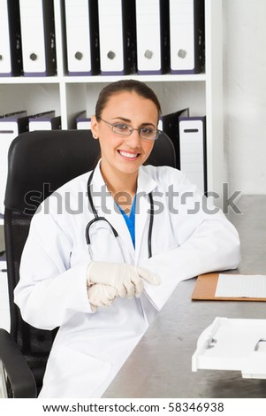 young female medical intern in office