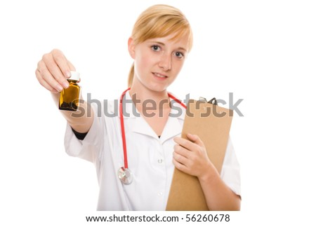 young female nurse holds small bottle with pills inside, studio shoot isolated on white background
