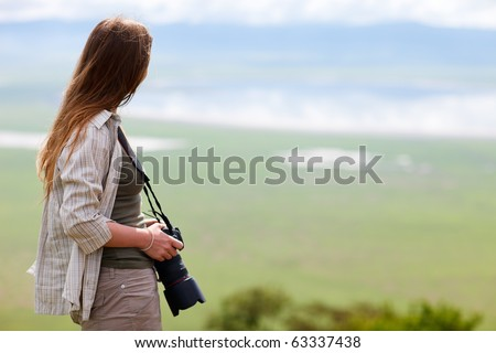 Young female photographer enjoying views of Ngorongoro crater in Tanzania