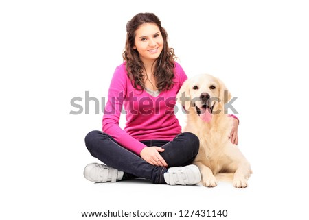 Young female posing with a labrador retriever isolated on white background