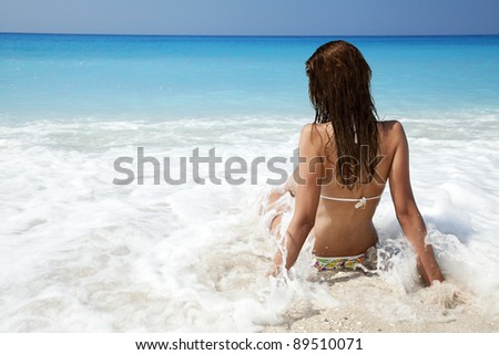 Young female relaxing on the beach