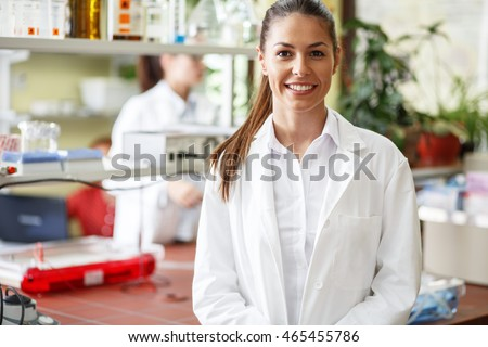 Young female scientist standing in her lab.