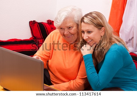 young female shows an senior how to use internet