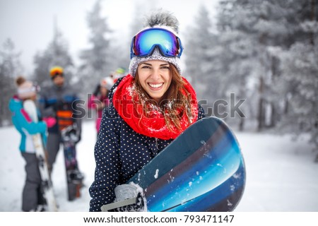 Young female snowboarder on winter vacation