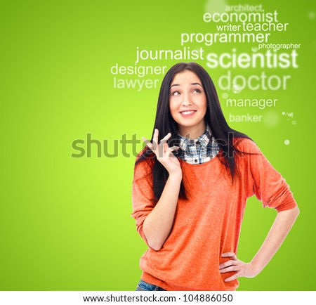 Young female student standing and thinking what profession to choose and start education