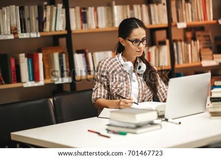 young female student study in...
