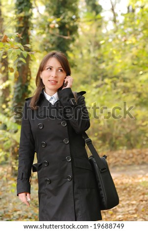 Young female student taking a call