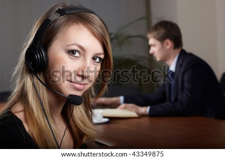 young female talk by  headset with microphone in office