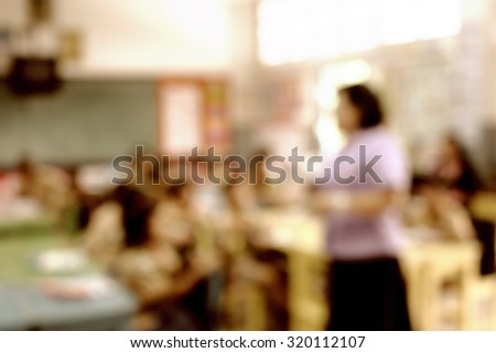 Young female teacher in front of classroom instruct social business and internet content and class activity for young students raise up hands