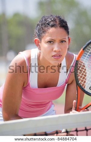 Young female tennis player outdoor playing