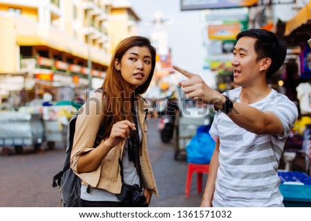 Young female tourist asking for directions and help from local people in Bangkok, Thailand Сток-фото ©
