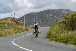 Young female traveler cyclist smiling on Connemara route Galway Ireland
