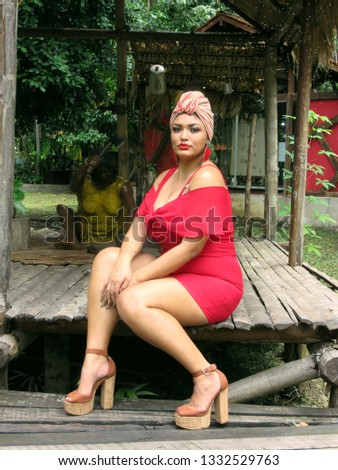 Young female turban model sitting on a porch #1332529763