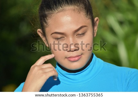 Young Filipina Female And Confusion
