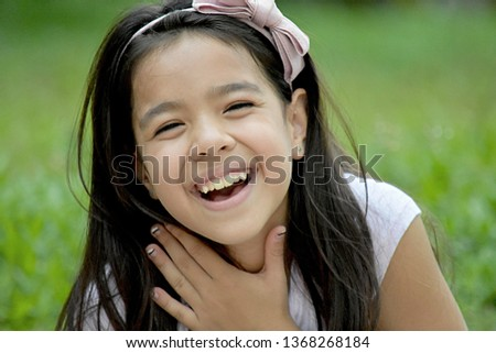 Young Filipina Female And Laughter