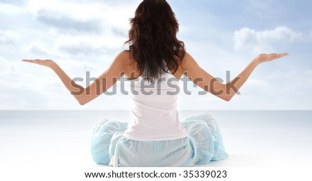 Young fit brunette meditating isolated on white