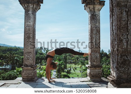 Young fit girl practicing yoga and meditation during her yoga retreat vacation in Bali