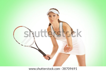 Young fit tennis player over green background
