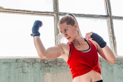 Young, fit woman box practicing. Uppercut punch