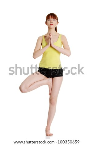 Young fit woman doing yoga exercise