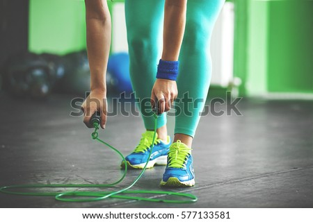 Young fit woman is taking jumping rope. #577133581