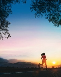 Young fitness Asian woman is running and jogging an outdoor workout on the road in the morning for lifestyle health.
