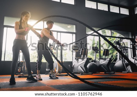 Young fitness couple in sports dress doing fitness exercise at gym,healthy sports lifestyle,relax concept.