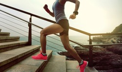 young fitness sports woman  trail runner running on seaside