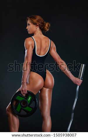 Young fitness woman athlete and bodybuilder with barbell. Individual sports. Sports recreation. #1505938007