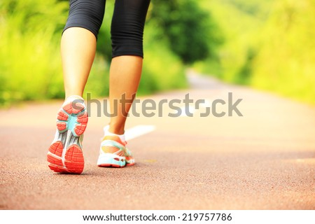 Shutterstock young fitness woman hiker legs  at forest trail