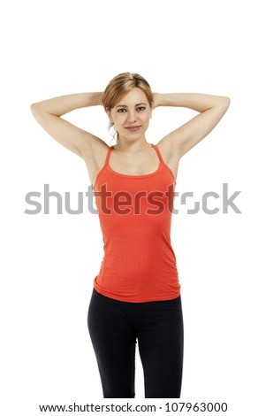 young fitness woman holding her arms over her head on white background